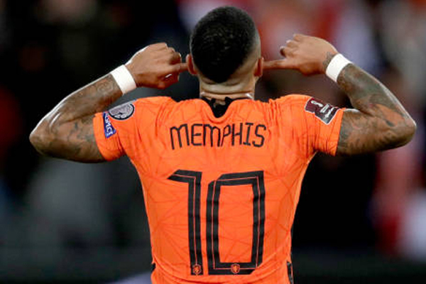 memphis-depay-of-holland-celebrates-scoring-the-thrid-goal-during-the-world-cup-qualifier.jpg